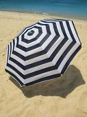 Striped umbrella on a sandy beach