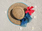 Sun hat on a sandy beach