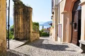 Narrow street of Menaggio town at the famous Italian lake Como