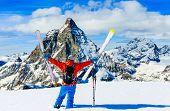 Man skiing on fresh powder snow. Ski in winter season, mountains and ski touring backcountry equipme poster