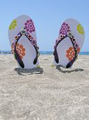 Flip-flops in the black sand of Tenerife island, Canaries