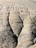 Desert formation of mud deeply cracked by erosion of the rain