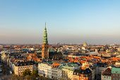 Copenhagen Skyline In Evening Light. Copenhagen Old Town And Copper Spiel Of Nikolaj Contemporary Ar poster