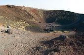 Tourists on the border of craters Silvestri of the Etna in Sicilia