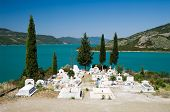 white cemetery on the shores of Lake Kremaston, Greece