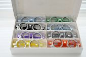 Ophthalmic Glasses With Lenses Are Folded Into The Cells Of The Case poster