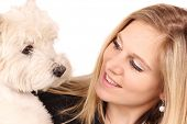 stock photo of beautiful women  - Attractive happy young woman with dog - JPG