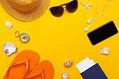 Composition Of Beachwear And Accessories On A Yellow Background poster