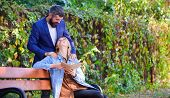Romantic Relations Concept. Couple In Love Romantic Date Nature Park Background. Girl Sit Bench Read poster