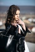 Fashion Woman With Stylish Makeup And Curly Hair. Pretty Girl With Fashionable Hair. Autumn Fashion  poster