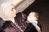 beautiful mother muslim with baby on sea