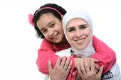 stock photo of muslim  - Muslim woman and her daughter is loving - JPG