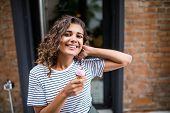 Mixed Race Curlu Woman Eating Ice Cream On Vacation Travel. Smiling Girl Having Fun Eating Icecream poster
