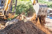 Working Excavator Tractor Digging A Trench At Construction Site. poster