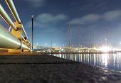 night scene of busy port, Singapore