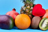 Assortment Of Tropical Fruits Close Up. Tropical Fruits Composition With Mango, Pomegranate, Orange, poster