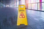 Yellow Caution wet floor sign on wet floor poster