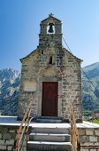 Old Chapel With A Bell Tower On The Background Of The Mountains. Stairs, Church And Bell Tower.close poster