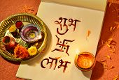 'Shubha Labha' (Prosperity and Profit) written in Hindi script on the notebook, arranged along w poster