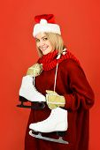 Ice Skating Concept. Woman In Santa Hat With Ice Skate. Happy Girl In Warm Sweater With Figure Skate poster