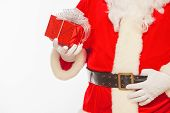 Photo Of Santa Claus Gloved Hands Holding Red Giftbox, Isolated poster