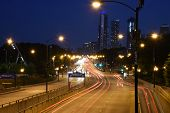 High Speed Road In Night Time Abstraction. City Road Car Light Trails Motion Background. Cars Light  poster