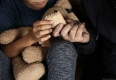 Poor Man Giving Piece Of Bread To His Son, Focus On Hands poster