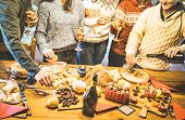 Side View Of Friends Group Tasting Christmas Sweets Food And Having Fun At Home Drinking Champagne S poster