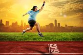 Attractive Asian Fat Man Running On Running Track With 2019 Number On The Start Line. New Year Resol poster