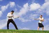 pic of peer-pressure  - tug of war business concept for rivalry and battle of the sexes - JPG