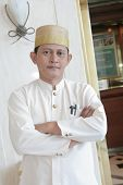 Bellboy Of Concierge Standing At Front Of Lift