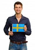 A Young Man Holding A Flag Of Sweden On White Background