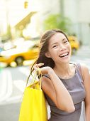 Shopping woman on Manhattan, New York City smiling happy excited walking holding shopping bags with
