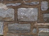 stock photo of fieldstone-wall  - stone wall with wide mortar joints - JPG