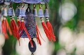 stock photo of chimes  - In feng shui bells are used to remove negative energy to bring harmony peace energy happiness and prosperity to the home - JPG