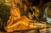 PHUKET ISLAND, THAILAND - AUGUST 12: statue of Reclining Buddha in buddhist suwankuha temple phang n