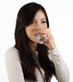 image of drinking water  - Beautiful young woman drinking water on white background - JPG