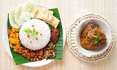Nasi lemak is traditional malaysia spicy rice dish, fresh cooked with hot steam. Served with belacan