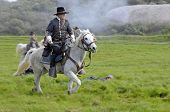 Confederate Cavalry Officer Riding On Battlefield