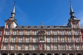 Architecture at Plaza Mayor in Madrid, Spain / Casa de la Panaderia / sunlight and blue sky