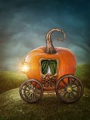 stock photo of cinderella coach  - Pumpkin orange carriage on the green meadow - JPG