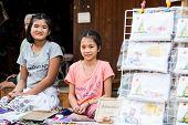 SUKHOTHAI, THAILAND - MAY 4: Unidentified girls are selling Thai traditional souvenir on May 4, 2013 at Rim Yom 2437 night market, Sukhothai, Thailand.