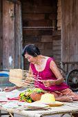 SUKHOTHAI, THAILAND - MAY 4: Unidentified mature woman is selling Thai traditional fan on May 4, 2013 at Rim Yom 2437 night market, Sukhothai, Thailand.