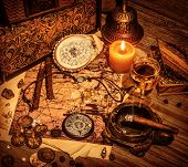 Closeup on beautiful buccaneer treasure background, luxury pirates alcohol drink, cigars, compass, p