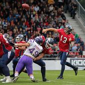VADUZ, LIECHTENSTEIN - JULY 21 QB Marko Glavic (#13 Broncos) passes the ball on July 21, 2012 in Vad