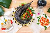 Sturgeon baked with vegetables and greens