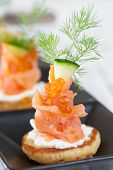Smoked Salmon And Sour Cream Appetiser, Garnished With Dill. Close-up View