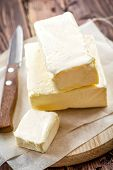 stock photo of margarine  - Fresh butter on a chopping board with knife - JPG