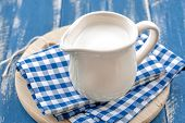 pic of jug  - Fresh milk in a jug on a wooden table - JPG