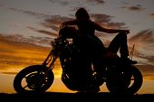 Silhouette Man Lay Back On Motorcycle Woman Over Him